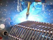 Сварка цилиндрических каркасов производится роботом аргоно-дуговой сварки